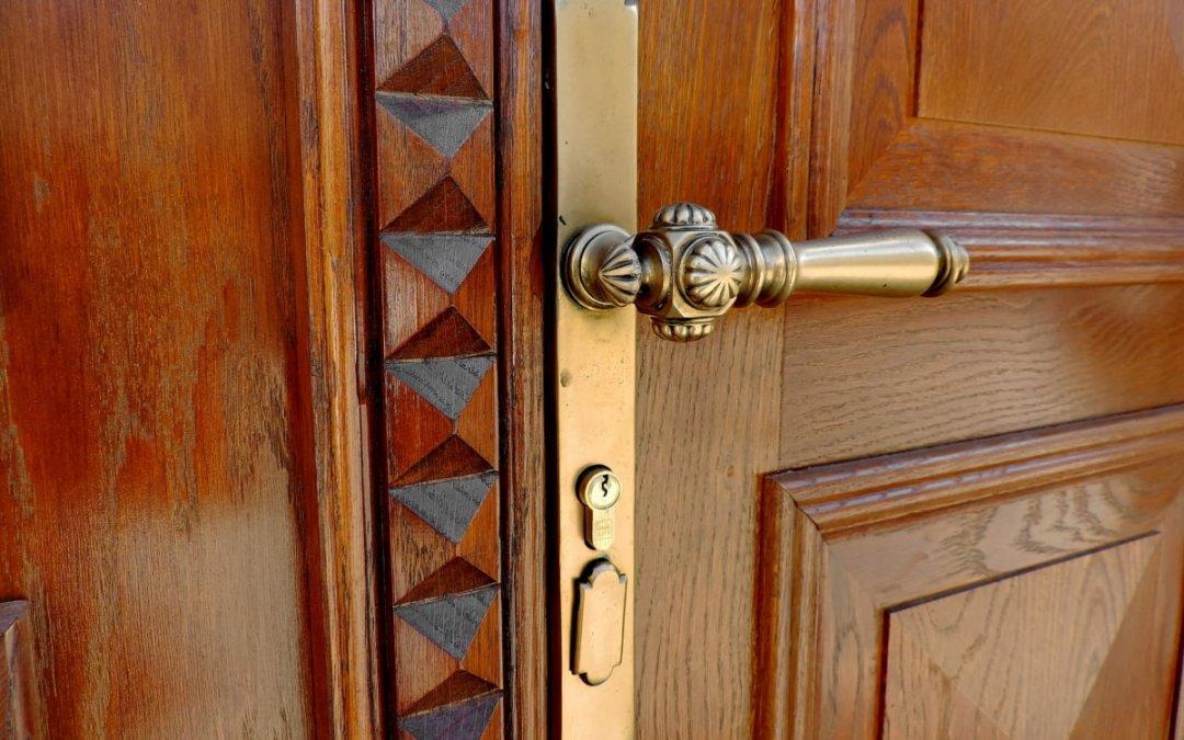 How do you refinish a wooden door?