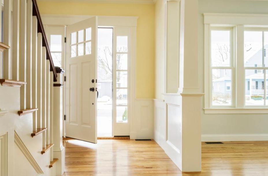 How do you protect a wooden door from sun damage?